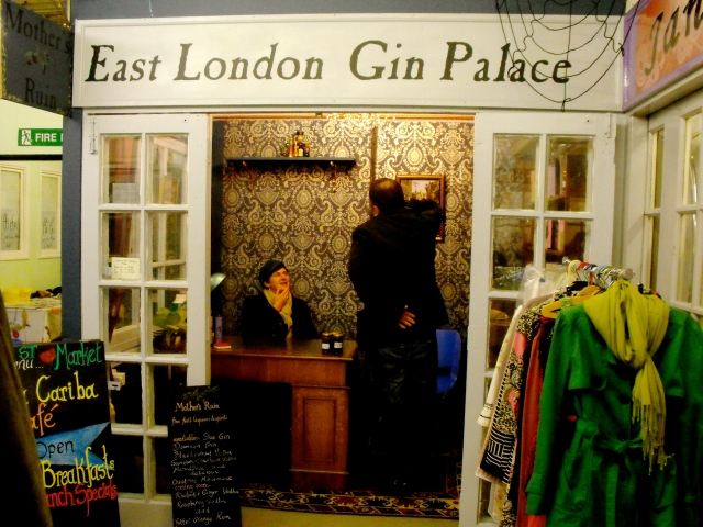 Becky in her gin palace with a customer